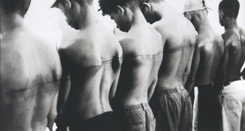 "Banner Image: Santiago Sierra, ""250 cm line tattooed on 6 paid people"" Havana, Cuba, 1999 (Video-Still) © Santiago Sierra. VG Bild-Kunst, Bonn 2017"